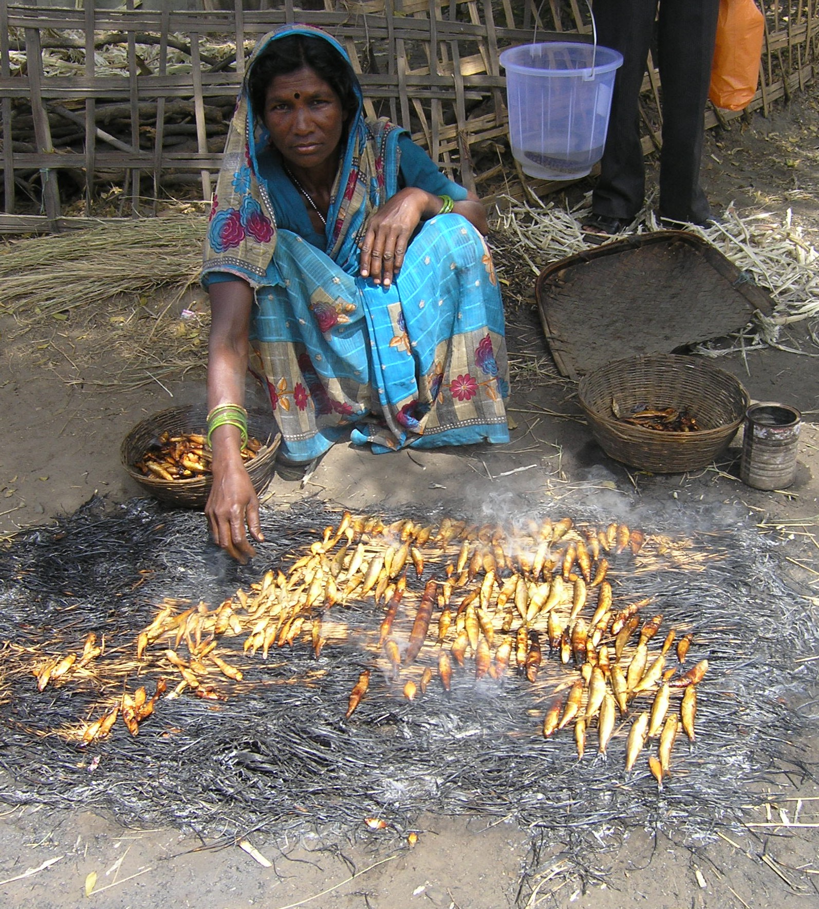 Traditional fish smoking by village woman in Madhya Pradesh, India. Photo: